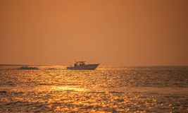 Morning glow. Fishing boat in the morning glow of the sun Royalty Free Stock Image
