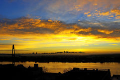 Morning glow over two cities separated by a river Stock Photography