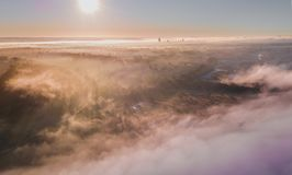Morning glow of the sun over a foggy misty field. royalty free stock photography