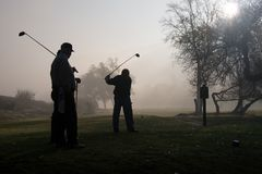 Morning Golfers royalty free stock photography