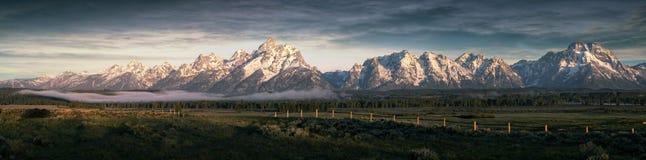 Morning at the Grand Tetons. Morning fog below the Teton Mountain range Stock Photography