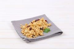 Morning granola with hazelnuts, raisins and cranberries Stock Photos