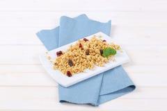 Morning granola with hazelnuts, raisins and cranberries Royalty Free Stock Photo