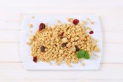 Morning granola with hazelnuts, raisins and cranberries Stock Photo