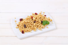 Morning granola with hazelnuts, raisins and cranberries Royalty Free Stock Photos