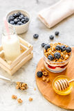Morning granola with yogurt, honey and berries on white table Royalty Free Stock Photo