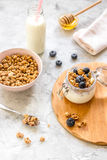 Morning granola with yogurt, honey and berries on white table Royalty Free Stock Photography