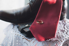 Morning groom. Wedding accessories. Tie shoes ring purse Stock Photo