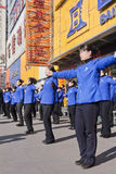 Morning group exercise in front of a shop, Changchun, China. CHANGCHUN, CHINA – OCT. 3, 2009. A morning group exercise on Oct. 3, 2009. Mass exercise makes a Royalty Free Stock Image
