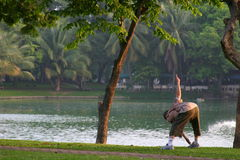 Morning gymnastics. At Lumphini parc, Bangkok Thailand every morning around 6 am loads of people come there to do their morning excercise Royalty Free Stock Photo