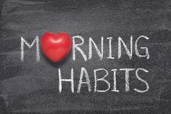 Morning habits heart. Morning habits phrase handwritten on chalkboard with red heart symbol instead of O Stock Photos
