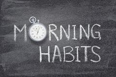 Morning habits watch. Morning habits phrase handwritten on chalkboard with vintage precise stopwatch used instead of O Royalty Free Stock Images
