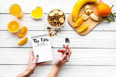 Morning habits of successful people. Healthy breakfast porridge with fruits and planning the day. White wooden. Background top view Royalty Free Stock Images