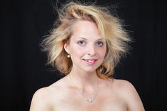 Morning hair. Pretty woman waking up to messy morning hair Stock Image
