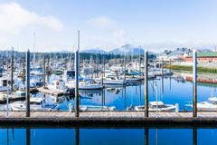 Morning harbor scene, private boats on calm water. Calm morning landscape of harbor piers brimming with fishing boats, Ketchikan, Alaska, USA stock images