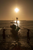 The Morning Harvest. This image was taken in a port in Quezon Province, Philippines. Once the boat reaches the dock, men would take the bins of fish and deliver stock photos