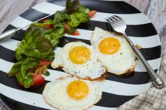Healthy Breakfast in the morning. scrambled eggs with fresh salad and vegetables. a plate on an old, bright, shabby table . royalty free stock photos
