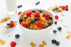 Morning healthy Breakfast honey Cornflakes with fresh fruits of Raspberry, blueberries.  Stock Image