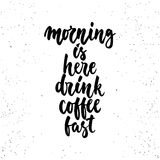 Morning is here drink coffee fast- lettering calligraphy phrase isolated on the background. Stock Image