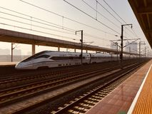 High-speed rail in the morning against the sun. In the morning, a high-speed rail that passes through the platform against the sun royalty free stock photos