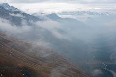 Mountain ranges partly engulfed in clouds royalty free stock photos