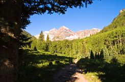 Morning Hike to Maroon Bells. Early morning hike along a rocky trail to Maroon Bells, Colorado stock image