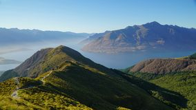 Morning hike to the top of Ben Lomond mountain, New Zealand royalty free stock photo