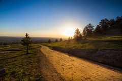 Morning hiking trail boulder colorado. Hiking trail with morning light overlooking Boulder Colorado seen from Chautauqua Open Space Park Royalty Free Stock Photography