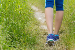 Morning hiking woman legs walking on trail. Royalty Free Stock Photography