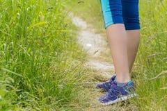 Morning hiking woman legs walking on trail. Stock Photo