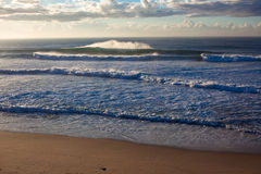 Morning Hollow Waves. View from a early morning Indian ocean waves that surges towards the reef along the Durban coastline in South Africa.Photo image captured Stock Photography