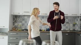 Morning at home happy young couple newly wed dancing listening to music in kitchen stock video