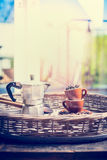 Morning home scene with espresso set , coffee cups, beans and coffee pot Royalty Free Stock Photos