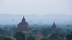 Morning hot air balloons over Bagan pagoda field stock footage