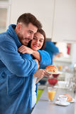 Morning hug in the kitchen stock photo