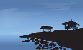 Morning with hut and rocks at the beach Royalty Free Stock Image