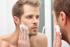 Morning hygiene in the bathroom Stock Images
