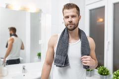 Morning hygiene, Man in the bathroom looking in mirror. Morning hygiene, Handsome man in the bathroom looking in mirror Stock Photo