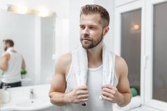 Morning hygiene, Man in the bathroom looking in mirror. Morning hygiene, Handsome man in the bathroom looking in mirror Stock Photos