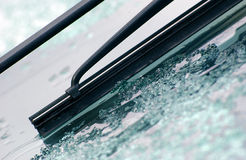 Morning ice on a windshield and wiper Royalty Free Stock Photography