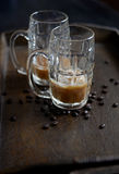 Morning Iced coffee. Wooden tray of brewed iced coffee with sugar heart and coffee beans, breakfast in bed Stock Photos
