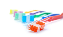 Morning II. Studio macro of a collection of brightly coloured toothbrushes against a white background. Copy space Royalty Free Stock Image