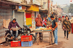 Morning of indian city with farm traders and man reading newspaper Royalty Free Stock Photos