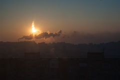 Morning in the industrial city, pollution concept. Morning in the industrial city, pipe smoke, pollution concept Royalty Free Stock Photography