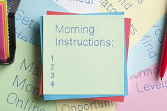 Morning Instructions written on a note Royalty Free Stock Image