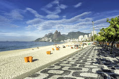 Morning on Ipanema Beach with mosaic walkway in Rio de Janeiro Stock Images