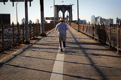 Morning jog across the bridge Royalty Free Stock Photography