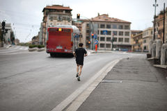 Morning jog along. The street of old Rome. Italy Stock Image