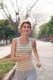 Morning jog. Cheerful woman jogging in the morning Royalty Free Stock Photos