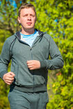 Morning jog man leading healthy lifestyle Stock Images